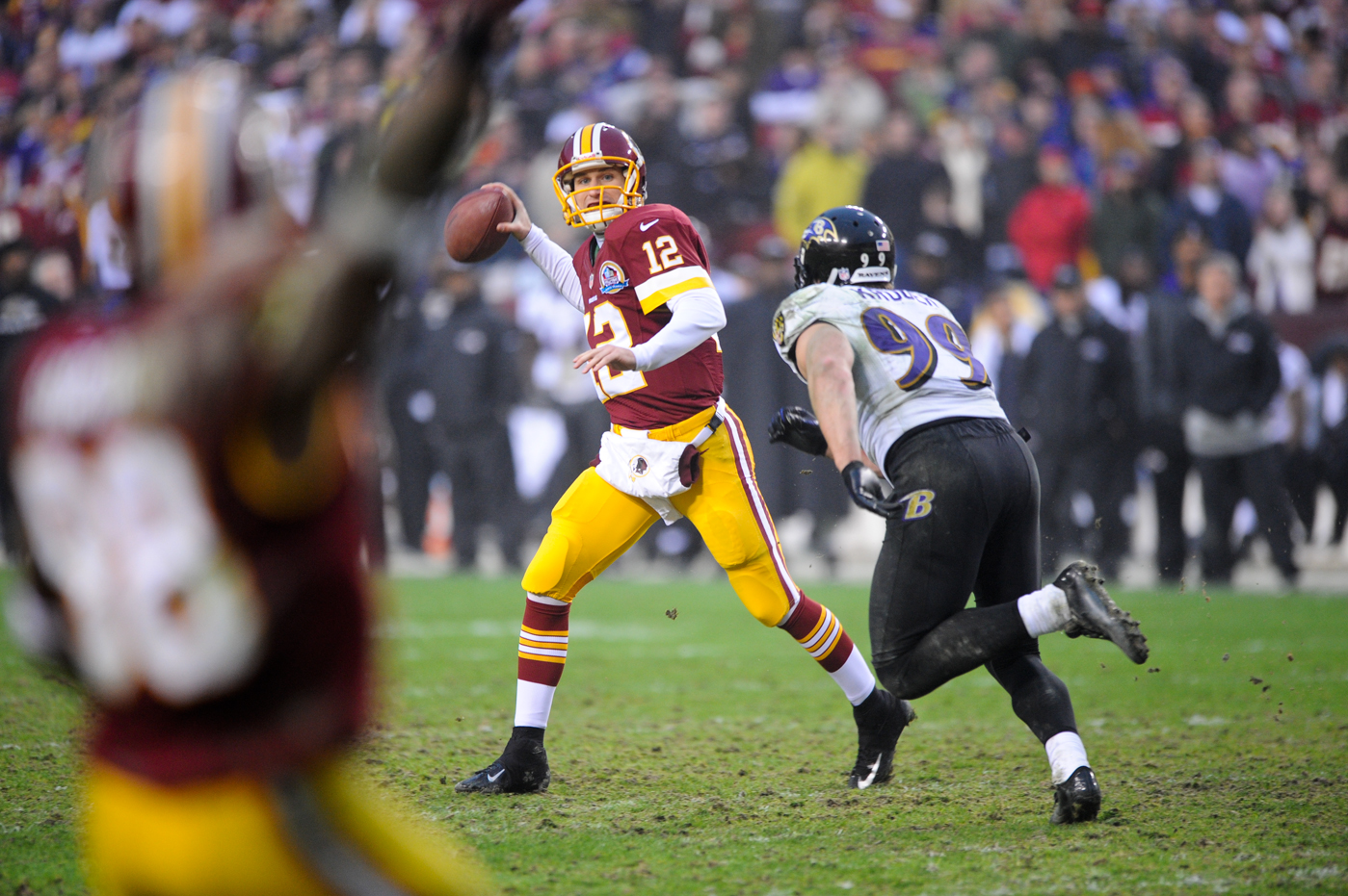 Redskins quarterback Kirk Cousins rolls out of the pocket and delivers a pass to receiver Pierre Garcon, who was wide open in the corner of the end zone.